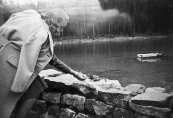 Jean Kellogg feeds a Chipmonk at Lake Louise